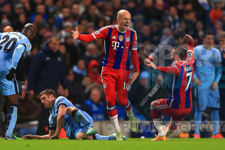 Arjen Robben of Munich knocks over team mate Franck Ribery in a fit of anger - Manchester City vs. Bayern Munich - UEFA Champion's League - Etihad Stadium - Manchester - 25/11/2014 Pic Philip Oldham/Sportimage