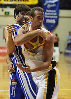 Tony Rampton steals a rebound off Kevin Owens during the NBL Basketball match between Wellington Saints and Devon Dynamos Taranaki at TSB Bank Arena, Wellington, New Zealand on Friday, 11 April 2008. Photo: Dave Lintott / lintottphoto.co.nz