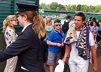 25-06-13, England, London,  AELTC, Wimbledon, Tennis, Wimbledon 2013, Day two, Igor Sijsling (NED) is being escorted bin police to the players lounge after he won the first round<br /> <br /> <br /> <br /> Photo: Henk Koster