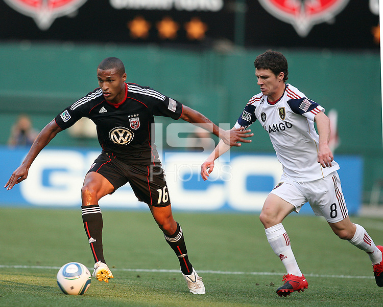 Jordan Graye #16 of D.C. United shields the ball from Will Johnson #8 of Real Salt Lake during an Open Cup match at RFK Stadium, on June 2 2010 in Washington DC. DC United won 2-1.