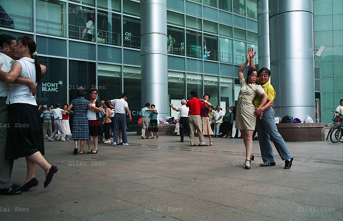 Dancing enthusiasts pairs up to strut their stuff on a square in Shanghai, China in September 2008.