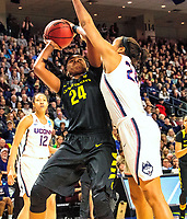 March 27, 2017 : Napheesa Collier blocks an Oregon shot by Ruthy Hebard as UCONN dominated 90-52 looking for their 12th national title during the NCAA Women's East Regional Final between the Oregon Ducks and Connecticut Huskies at the Webster Bank Center in Bridgeport, Connecticut. Dan Heary/ESW/CSM