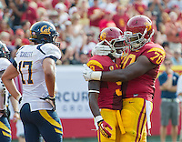 LOS ANGELES, CA - September 22, 2012:  USC wide receiver Marqise Lee (9) celebrates his touchdown with offensive tackle Aundrey Walker (70) during the USC Trojans vs the Cal Bears at the Los Angeles Memorial Coliseum in Los Angeles, CA. Final score USC 27, Cal 9..