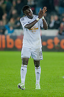 Saturday 29th November 2014<br /> Pictured: Bafetibis Gomis of Swansea City applauds fans as he leaves the field <br /> Re: Barclays Premier League Swansea City v Crystal Palace at the Liberty Stadium, Swansea, Wales,UK