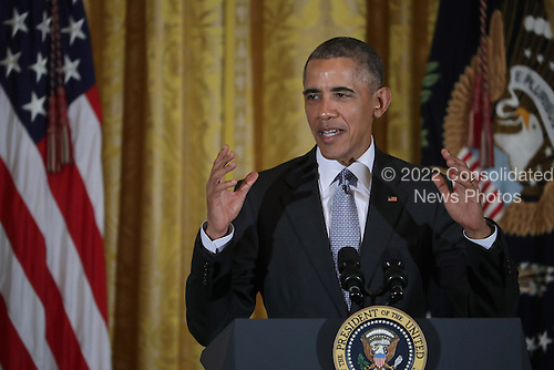 United States President Barack Obama delivers remarks during a reception for Women's History Month in the East Room of the White House March 16, 2016 in Washington, DC. Obama announced the White House will host a summit on The United State of Women this May. According to the White House, the summit will &quot;highlight the advances we have made in the United States and across the globe and to expand our efforts on helping women confront the challenges they face and reach for their highest aspirations.&quot; <br /> Credit: Chip Somodevilla / Pool via CNP