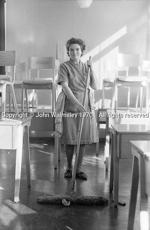 School cleaners at the end of the day, Whitworth Comprehensive School, Whitworth, Lancashire.  1970.