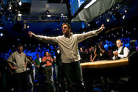 After 13 hours and 56 minutes, the longest final table in Wolrd Series of Poker history,  professional poker player Joseph Hachem, 39, from Australia, celebrates his victory as Steven Dannenmann, 38, left, who finished second, looks on at the final table of the 36th annual World Series of Poker at Binion's Gambling Hall & Hotel on July 16, 2005 in Las Vegas, Nevada. Hachem won the tournament, and the first place prize of $7.5 million dollars, the highest prize purse of any sanctioned sporting event. Dannenmann won second prize which was $4.25 million.(Photo by Landon Nordeman)