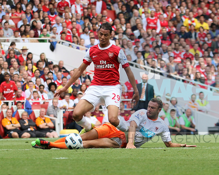 Blackpool's Ian Evatt gets sent off for a tackle on Arsenal's Marouane Chamakh