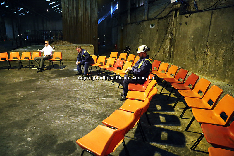 "Pictured: Actors Ioan Hefin, Simon Nehan and Sion Tudor Owen<br /> Re: Press rehearsal of ""We'Re Still Here"", a play created by Rachel Trezise, Common Wealth and the National Theatre Wales about steelworkers, which will be performed in Byass Works, a disused industrial unit, in Port Talbot, south Wales, UK."