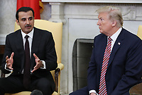 U.S. President Donald Trump listens to the Emir of Qatar Sheikh Tamim bin Hamad Al Thani, speak during a meeting in the Oval Office at the White House, on April 10, 2018 in Washington, DC. President Trump has announced that he canceled his upcoming trip to the 8th annual Summit of the Americas in Lima, Peru.  <br /> <br /> CAP/MPI/RS<br /> &copy;RS/MPI/Capital Pictures