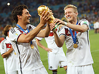 Andre Schurrle and Mats Hummels of Germany lifts the World Cup trophy after winning the 2014 final