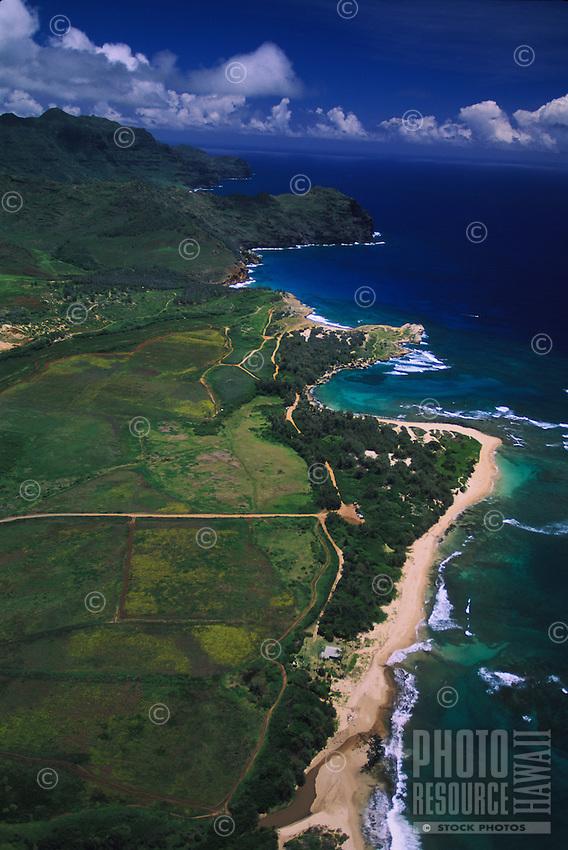 Aerial over Mahaulepu Beach beyond Shipwreck's and Poipu Beach and the south shore coastline of Kauai, Hawaii