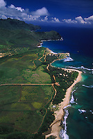 Aerial over Mahaulepu Beach beyond Shipwreck's and Poipu Beach and the south shore coastline of Kauai, Hawaii
