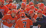 Head coach Jack Leggett (7) jumps into a pile of his players prior to a game between the Charlotte 49ers and Clemson Tigers Feb. 20, 2009, at Doug Kingsmore Stadium in Clemson, S.C.