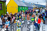 Big crowds line both sides of Cloghane village for the annual Féile Lughnasa parade last Sunday.