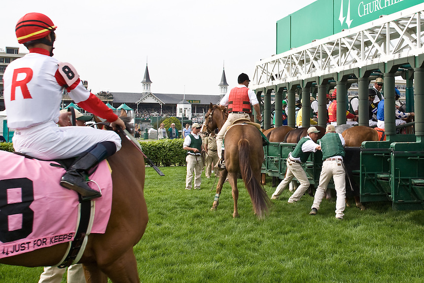The starting crew loads the gates for a grass track horse race at Churchill Downs in Louisville, Kentucky. Start crews work seasonally and are busy during Triple Crown season which includes the Kentucky Derby.