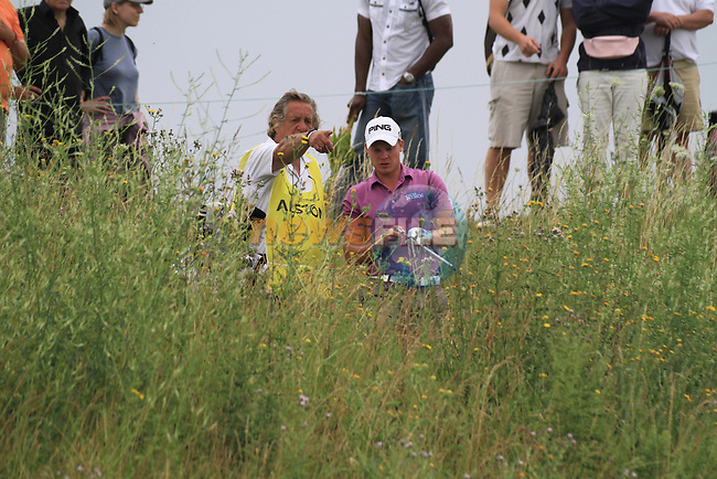 Danny Willet playing into the 9th green from the top of the bank in three foot weeds on day three of the Alstom Open de France at .Golf National St Quentin en Yvelines, Paris France, 3/7/10.. Picture Fran Caffrey/www.newsfile.ie