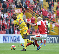 BOGOTA - COLOMBIA -10 -11-2013: Omar Perez (Der.) mediocampista de Independiente Santa Fe disputa el balón con Cesar Valoyes (Izq.) jugador del Atletico Huila, durante del partido por la fecha 18 de la Liga Postobon II-2013, jugado en el estadio Nemesio Camacho El Campin de la ciudad de Bogota. / Omar Perez (L) midfielder  of Independiente Santa Fe vies for the ball with Cesar Valoyes (L) player of Atletico Huila during a match for the 18 date of the Postobon Leaguje II-2013 at the Nemesio Camacho El Campin Stadium in Bogota city, Photo: VizzorImage  / Luis Ramirez / Staff.