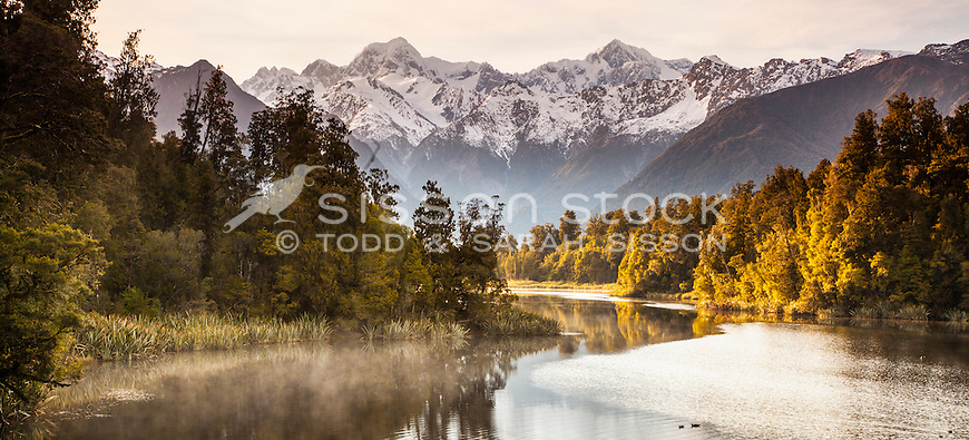 Golden morning light and mist at Lake Matheson, South Island, New Zealand - stock photo, canvas, fine art print