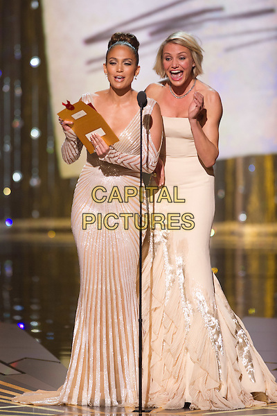 Jennifer Lopez and Cameron Diaz present at the 84th Annual Academy Awards® from Hollywood, CA February 26, 2012..*Editorial Use Only*.oscars full length stage dress white silver strapless mouth open.CAP/A.M.P.A.S./NFS.©A.M.P.A.S. Supplied by Capital Pictures.