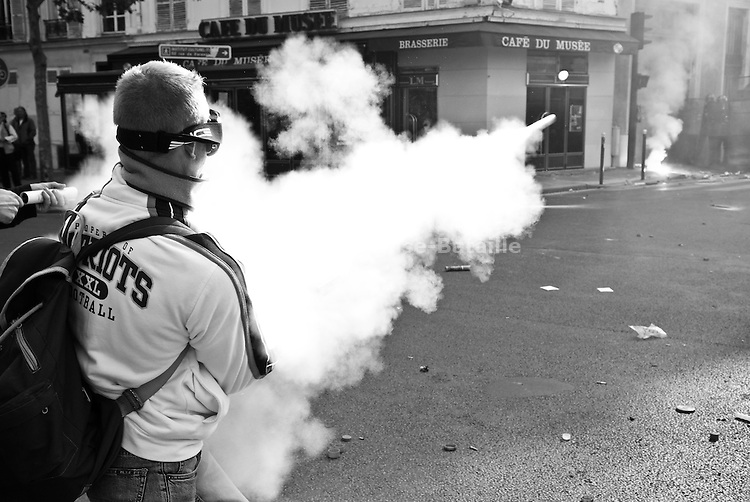 A fisherman aims a rocket at riot police securing the entrance of the Agriculture Ministry during a protest in Paris on May 21, 2008.