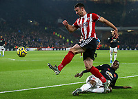 24th November 2019; Bramall Lane, Sheffield, Yorkshire, England; English Premier League Football, Sheffield United versus Manchester United; Enda Stevens  of Sheffield United crosses the ball as Aaron Wan-Bissaka of Manchester United slides in to challenge him - Strictly Editorial Use Only. No use with unauthorized audio, video, data, fixture lists, club/league logos or 'live' services. Online in-match use limited to 120 images, no video emulation. No use in betting, games or single club/league/player publications
