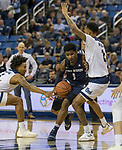 Utah State  guard  Tauriawn Knight (1) drives thru the Nevada defense in the second half of an NCAA college basketball game in Reno, Nev.,  Wednesday, Jan. 2, 2019. (AP Photo/Tom R. Smedes)