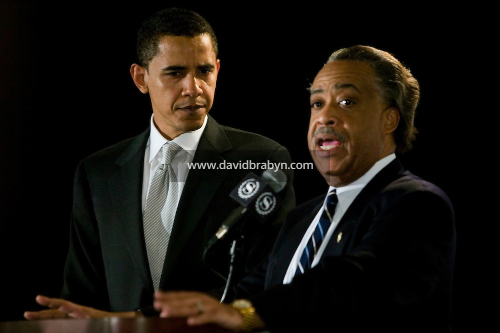 21 April 2007 - New York City, NY - The Reverend Al Sharpton (R) speaks as Democratic presidential hopeful Senator Barack Obama listens at the 9th Annual National Action Network Convention in New York City, USA, April 2007.