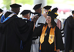 Graduate Stephanie Cisneros receives her diploama during the 45th annual Western Nevada College Commencement ceremony in Carson City, Nev., on Monday, May 23, 2016. A record 556 graduates received 598 degrees.<br />