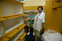 Flushing, NY - 16 August 2005 - Womens' lockeroom supervisor, Gloria Beckford (R) and her colleague, Liliana Taylor, pose by lockers 113 and 114 (L, top and middle respectively) that the Williams sisters used last year and requested to use again this year at the Arthur Ash stadium at the National Tennis Center - home of the US Open - in Flushing, Queens, NY, USA, 16 August 2005. Gloria has looked after the US Open womens' lockeroom for the past 25 years.