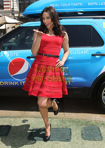 "Paula Patton.Paula Patton Invites Fans To Sample New Pepsi Next For ""Drink It To Believe It"" Campaign Held at The Grove, Los Angeles, California, USA..April 9th, 2012.full length red sleeveless dress black belt hand on hip leg foot up blowing kiss .CAP/ADM/KB.©Kevan Brooks/AdMedia/Capital Pictures."