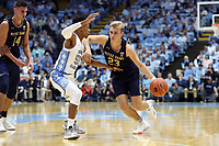 CHAPEL HILL, NC - NOVEMBER 06: Dane Goodwin #23 of the University of Notre Dame drives against Christian Keeling #55 of the University of North Carolina during a game between Notre Dame and North Carolina at Dean E. Smith Center on November 06, 2019 in Chapel Hill, North Carolina.