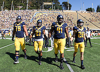 California captains' Freddie Tagaloa, Caleb Coleman, Deandre Coleman and Jackson Bouza walk on the field for coin toss before the game against Washington State at Memorial Stadium in Berkeley, California on October 5th, 2013.  Washington State defeated California, 44-22.