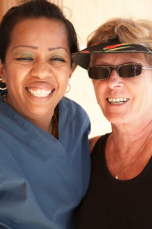 Female tourist and her dental hygienist showing off their smiles in Los Algodones, B.C, Mexico.
