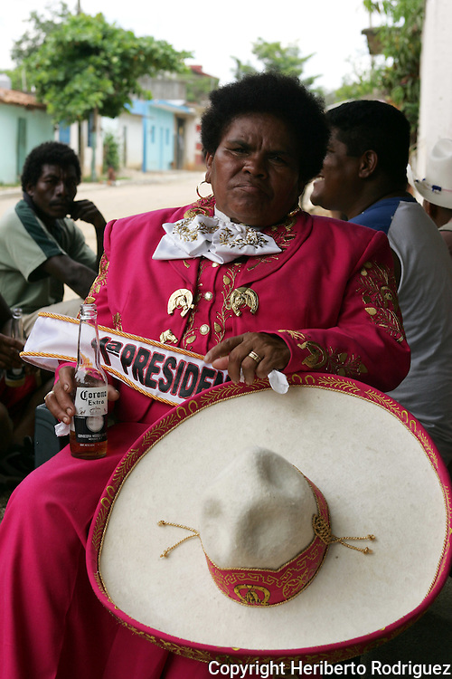 Mrs. Marcelina Salinas, 57, poses for a photograph as President of the Mayordomia of Santiago Apostol in Cuajinicuilapa town, in Costa Chica in southern state of Guerrero. Mrs. Salinas delivered her mandate to the new President Sara Camero duirng the festivities to pay honor to Santiago Apostol, one of the patron saints of this AfroMexican town. Photo by Heriberto Rodriguez ..