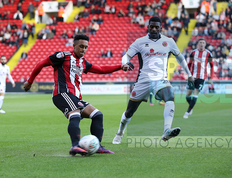 Jack Bennett of Sheffield United in action with Amadou Bakayoko of Walsall during the Carabao Cup round One match at Bramall Lane Stadium, Sheffield. Picture date 9th August 2017. Picture credit should read: Jamie Tyerman/Sportimage