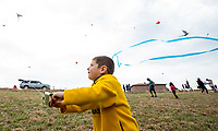 NWA Democrat-Gazette/BEN GOFF @NWABENGOFF<br /> Silas Trujillo, 4, of Rogers flies his kite Saturday, March 23, 2019, during the 29th annual Eureka Springs Kite Festival hosted by Turpentine Creek Wildlife Refuge in Eureka Springs. The free family event included kite making and kites for sale from Keleidokites in Eureka Springs and a variety of food trucks and entertainment. Strong wind kept dozens of kites flying high at any given time.