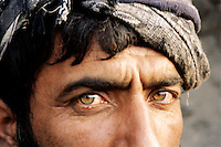 Emerald eyes of a miner digging by hand in a hunt of emeralds at 4000 meters high, in the Panshir valley.