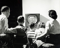 Family watching television. 1950's.<br />