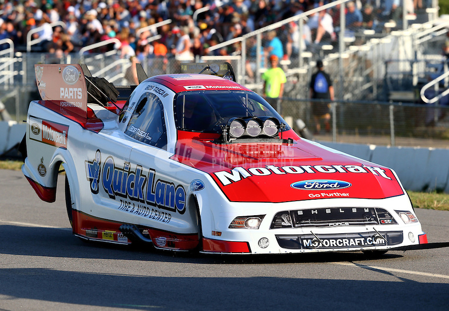 Aug. 16, 2013; Brainerd, MN, USA: NHRA funny car driver Bob Tasca III on the return road during qualifying for the Lucas Oil Nationals at Brainerd International Raceway. Mandatory Credit: Mark J. Rebilas-