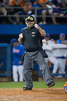 Home plate umpire Tony Norris calls a batter out on strikes in Game One of the Gainesville Super Regional of the 2017 College World Series between the Wake Forest Demon Deacons and the Florida Gators at Alfred McKethan Stadium at Perry Field on June 10, 2017 in Gainesville, Florida.  The Gators defeated the Demon Deacons 2-1 in 11 innings.  (Brian Westerholt/Four Seam Images)