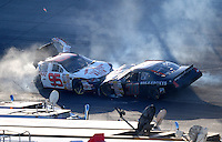 Sept 19, 2008; Dover, DE, USA; NASCAR Camping World Series East driver Tim Andrews (95) is hit by Jeff Anton (30) during the Sunoco 150 at Dover International Speedway. Mandatory Credit: Mark J. Rebilas-