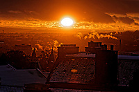 The sun sets over roof tops in Edinburgh, Scotland, UK. Wednesday 04 April 2018