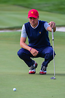 Justin Thomas (USA) lines up his putt on 14 during round 3 Foursomes of the 2017 President's Cup, Liberty National Golf Club, Jersey City, New Jersey, USA. 9/30/2017.<br /> Picture: Golffile | Ken Murray<br /> <br /> All photo usage must carry mandatory copyright credit (&copy; Golffile | Ken Murray)