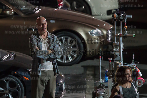 US actor Bruce Willis on set during a shooting of his next movie fifth in the Die Hard series titled Good Day to Die Hard in Budapest, Hungary on July 11, 2012. ATTILA VOLGYI