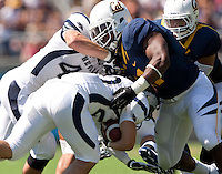 September 1, 2012: California's Nick Forbes tackles Nevada's Stefphon Jefferson during a game at Memorial Stadium, Berkeley, Ca   Nevada defeated California 31 - 24
