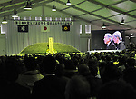 March 11, 2012, Rikuzentakata, Japan ? The images of Emperor Akihito and Empress Michiko are shown on a huge screen in a live broadcast from Tokyo during a memorial service in Rikuzentakata, Iwate Prefecture, some 402 km northeast of Tokyo, on Sunday, March 11, 2012..Memorial ceremonies were held throughout Japan to mark the one year anniversary of the massive earthquake and tsunami that struck Japan?fs northeastern region, killing just over 19,000 people and unleashing the world?fs worst nuclear crisis in a quarter century. The quake was the strongest recorded in the nation?fs history, and set off a tsunami that towered more than 65 feet in some spots along the northeastern coast, destroying thousands of homes and wreaking widespread destruction. (Photo by Natsuki Sakai/AFLO) AYF -mis-.