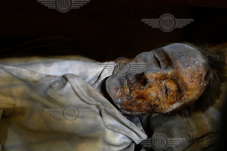 The body of a man lies in the underground corridors in the Catacombs in Palermo. In 1599, Capuchin monks discovered that these catacombs contained a preservative that helped mummify dead bodies. As a result, between 1500 and 1920 more than 8,000 Sicilians chose to be buried here.
