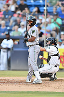 Augusta GreenJackets center fielder Heliot Ramos (14) looks for coaches signals during a game against the Asheville Tourists at McCormick Field on June 15, 2018 in Asheville, North Carolina. The Tourists defeated the GreenJackets 6-5. (Tony Farlow/Four Seam Images)