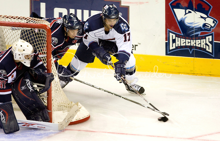 Hockey action during a Charlotte Checker minor league hockey game at Time Warner Cable Arena in Charlotte, NC.